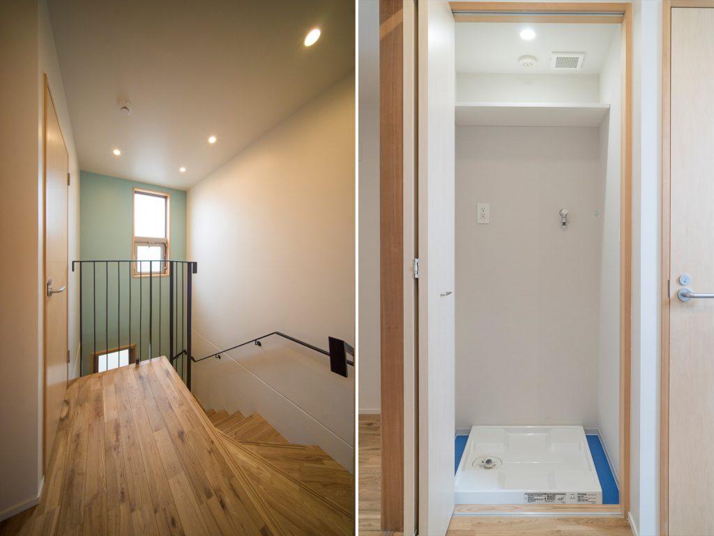 水色のクロスが爽やかな階段。階段横には洗濯機置場があります。