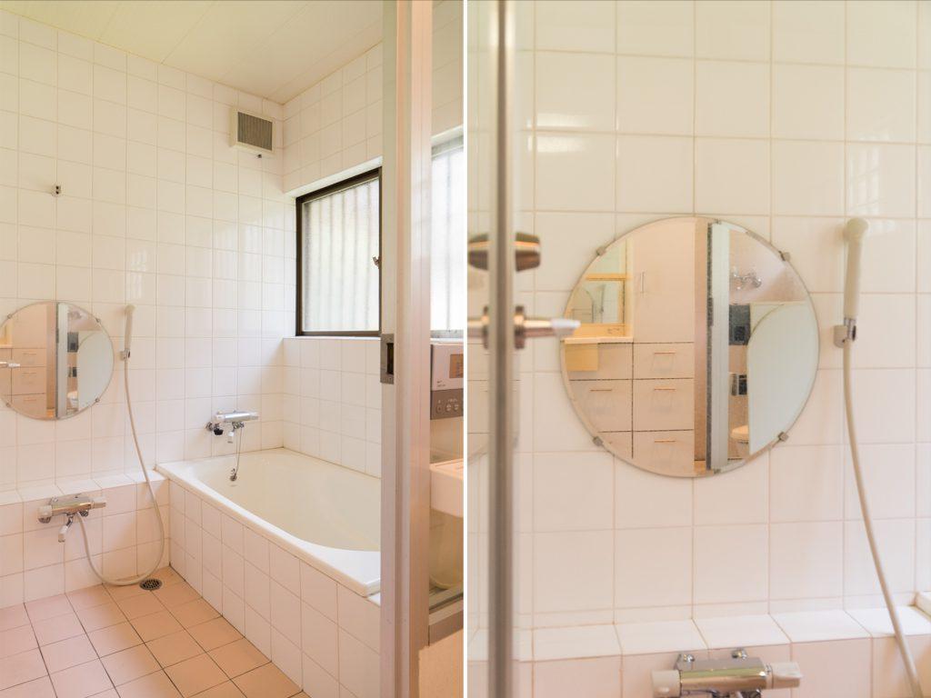 白とピンクタイルのお風呂。まるい鏡がかわいい。