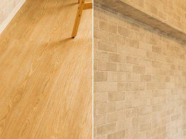 木目調のフローリングに、洋室には一面部分にレンガのアクセントクロスが貼られています。