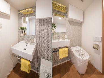 アクセントクロスが貼られた洗面室にあるのは、洗濯機置き場とトイレ。