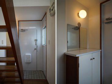 玄関、靴箱と鏡とライトがいい雰囲気