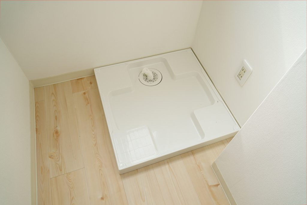 洗濯機置き場は、リビングの一角にあります。